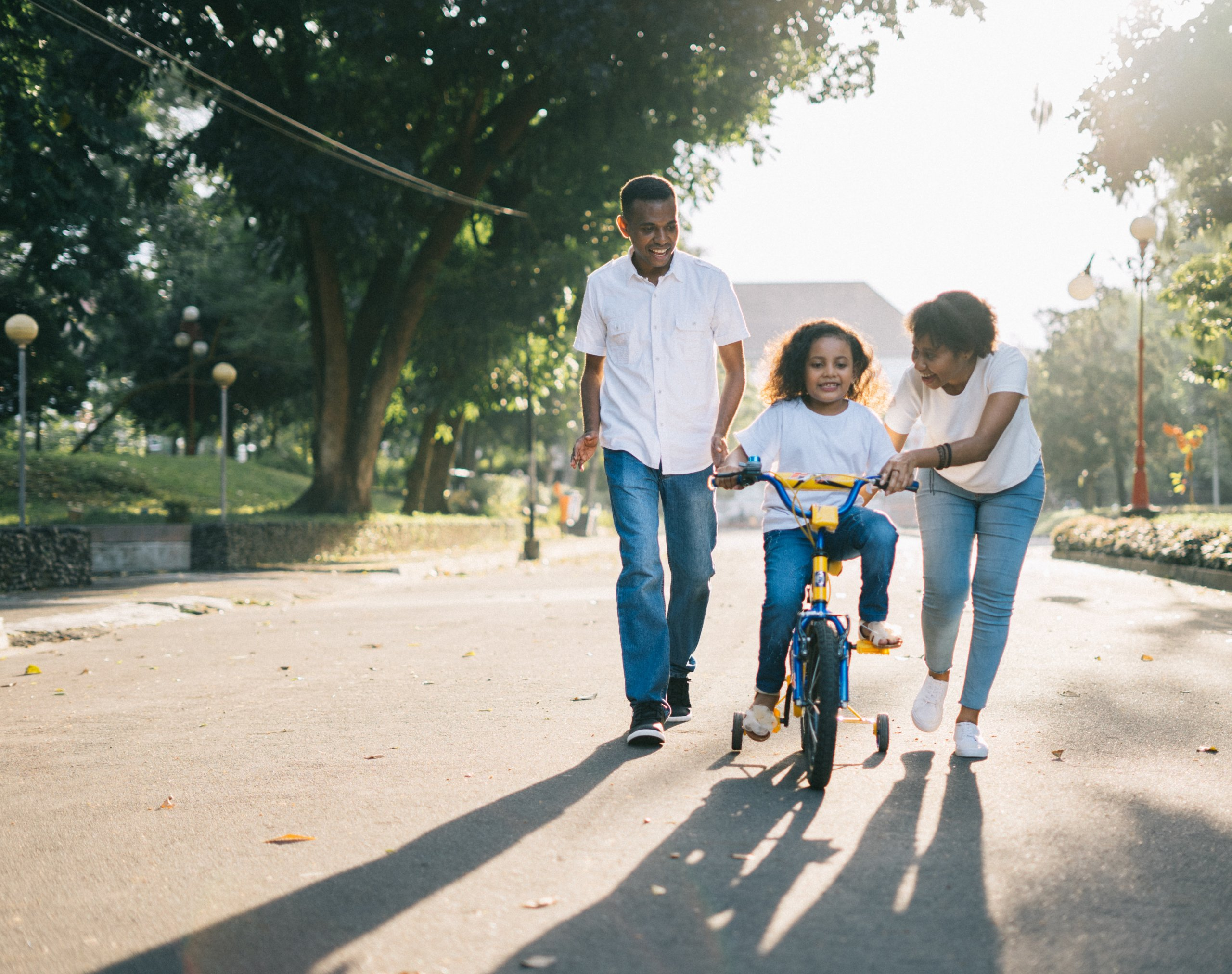 a couple with a child on a bike